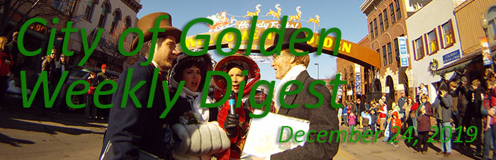 Carolers sing at the Olde Golden Christmas parade