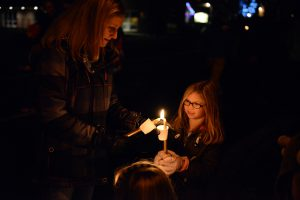 Candlelight Walk, lighting candles
