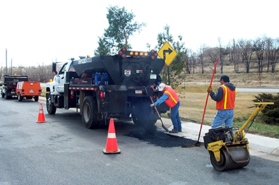 Public Works crew filling potholes