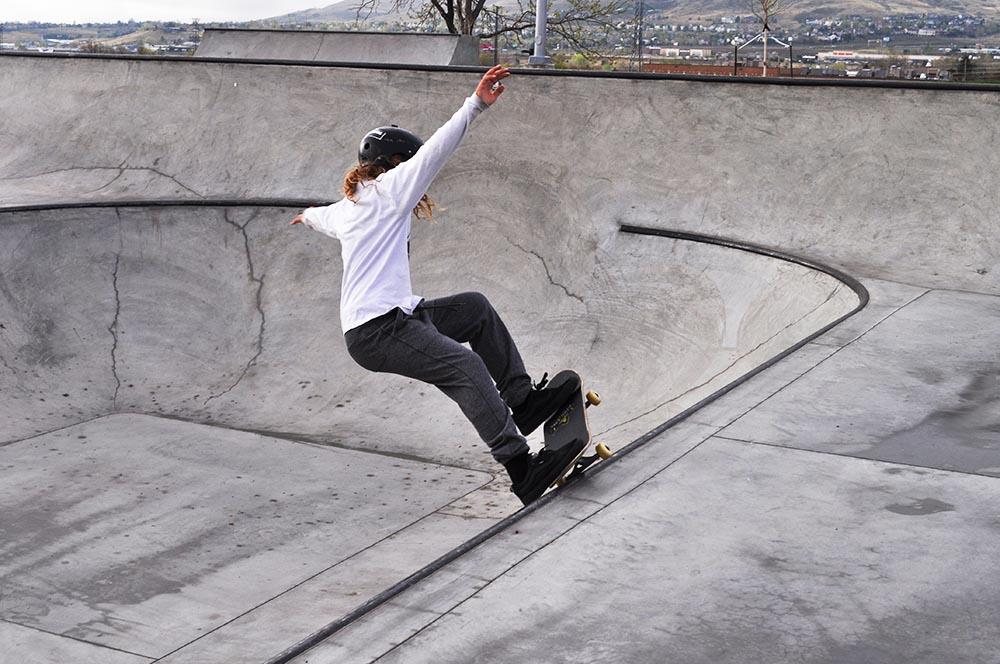 Skate boarder skating at Ulysses skate park