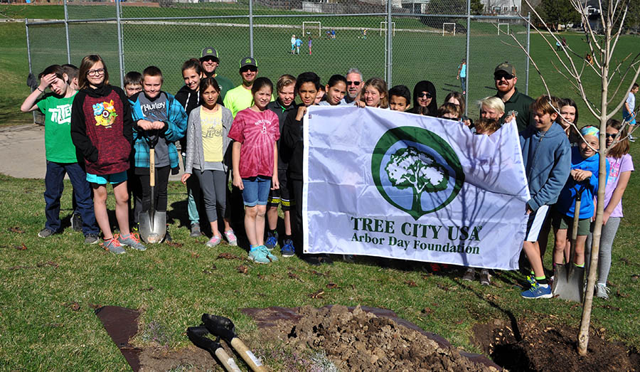 Tree planting demonstration with Shelton Elementary students.