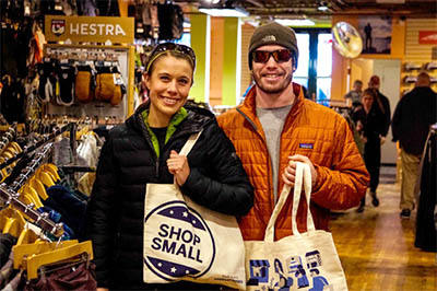 a man and woman shopping on small business saturday